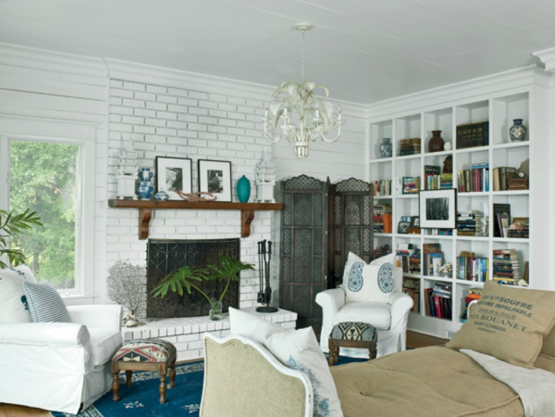 Coastal living room with white slipcover chairs and a mixture of old and new