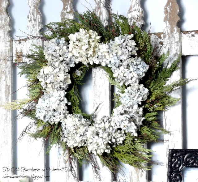 Evergreen and hydrangea wreath - By The Olde Farmhouse on Windmill Hill featured on I Love That Junk