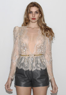 Vintage 1970's nude colored sheer lace top with sequin and bead embellishments and scalloped hemline.