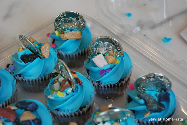 "Add chocolate ""jewels"" and plastic coins to store bought cupcakes for a pirate party!"