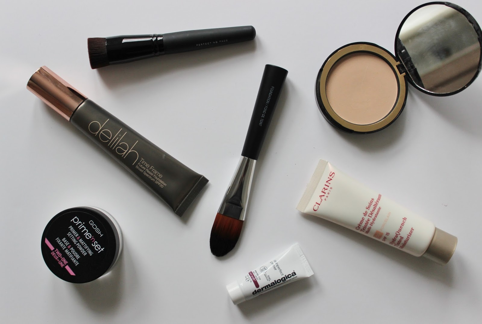 foundation, powders and makeup brushes