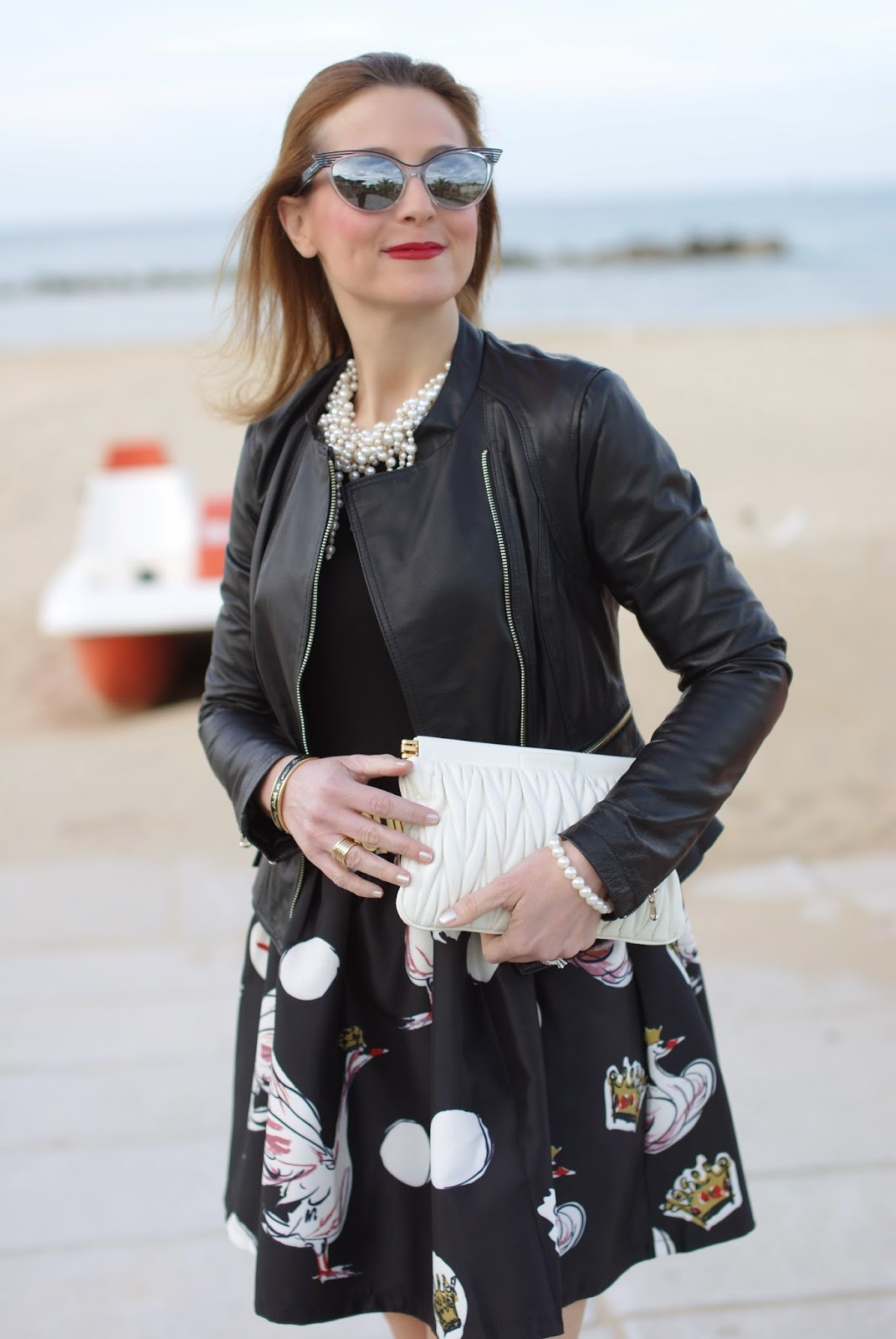 Miu Miu white quilted clutch, black leather jacket and Zara pearl necklace on Fashion and Cookies fashion blog, fashion blogger style