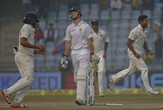 South Africa's Dane Vilas, center, walks back after being bowled by Umesh Yadav. (AP)