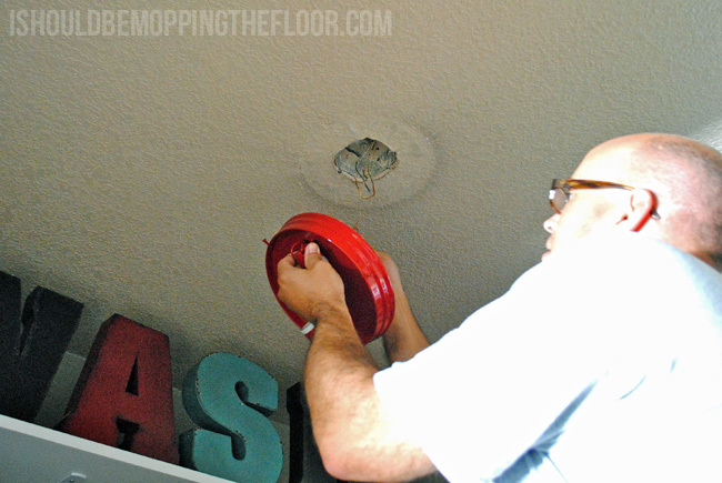 Transforming a dated light fixture with a dollar store item!