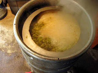 Boiling hops in Nathan's keggle.