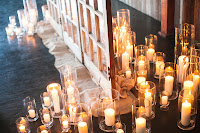 Candles light the ceremony triptych at Sodo Park