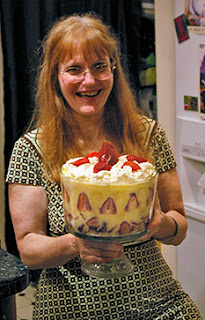 Robin holding huge strawberry trifle at party