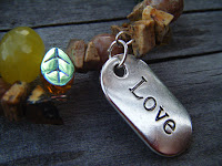 Love charm on bracelet