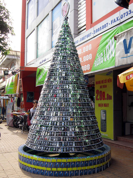 the store is ringing in christmas with the 15 foot tree made of more than 2500 unusable mobiles store manager nguyen trai said 10 workers spent two weeks - 15 Foot Christmas Tree