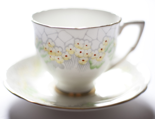 vintage teacup with yellow flowers