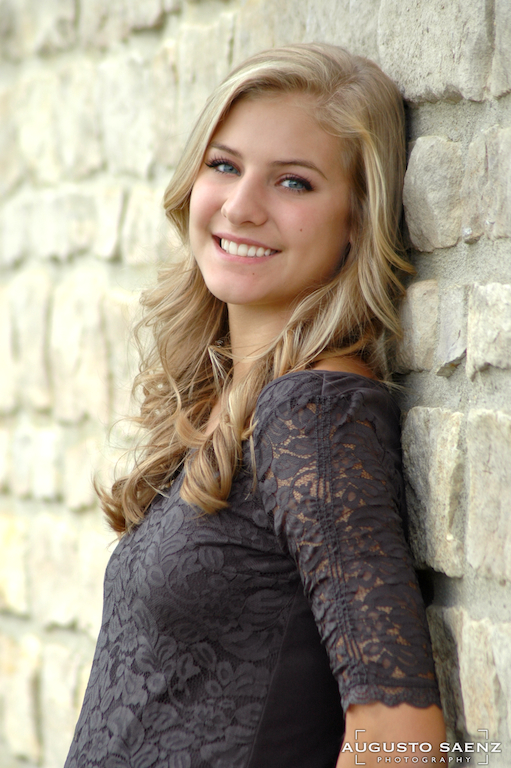 Senior Picture of Olivia leaning on wall Columbus, OH