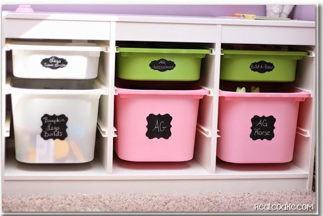 An organized playroom using chalkboard labels to help toy storage stay organized. #Organizing #Playroom #Chalkboard