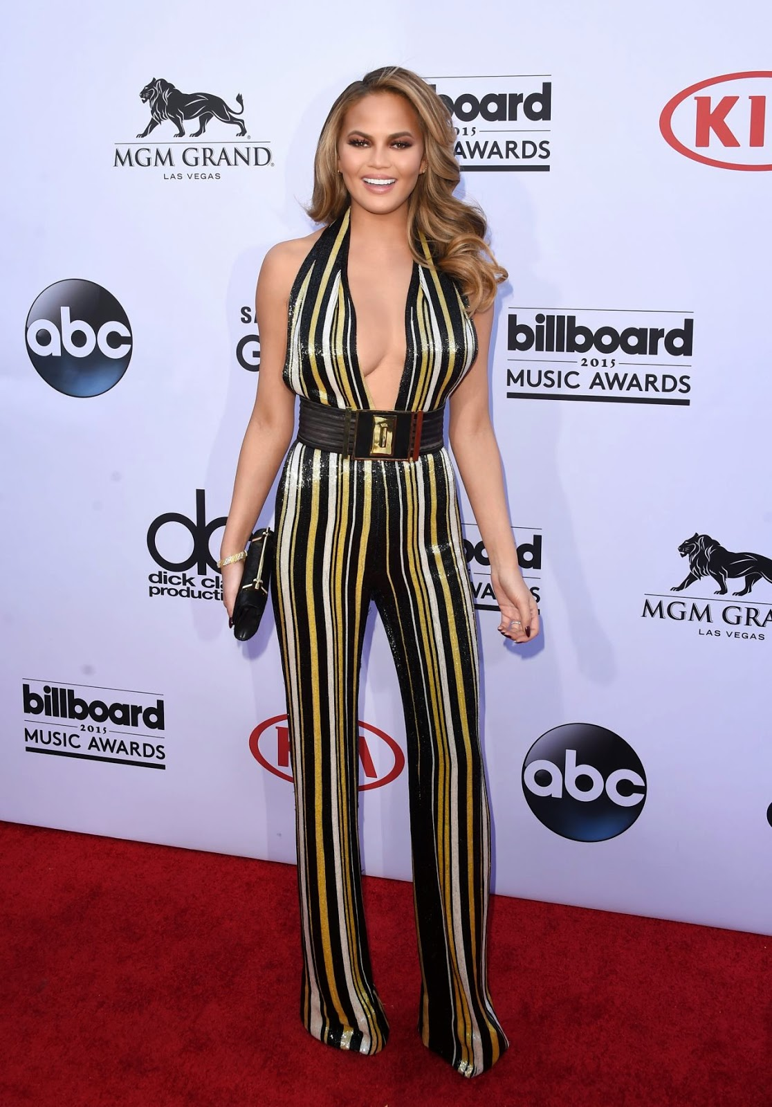 Chrissy Teigen flaunts curves in a Balmain jumpsuit at the 2015 Billboard Music Awards