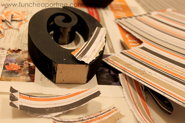 Putting scrapbooking paper on a wooden letter O, from Fun Cheap or Free