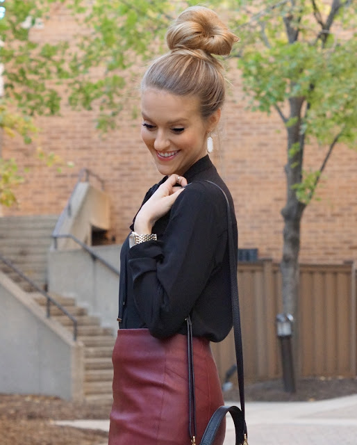 top knot with black blouse
