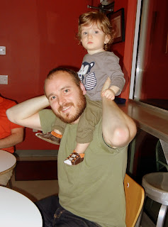 Wesley sitting on Jay's shoulders at Torchy's Tacos