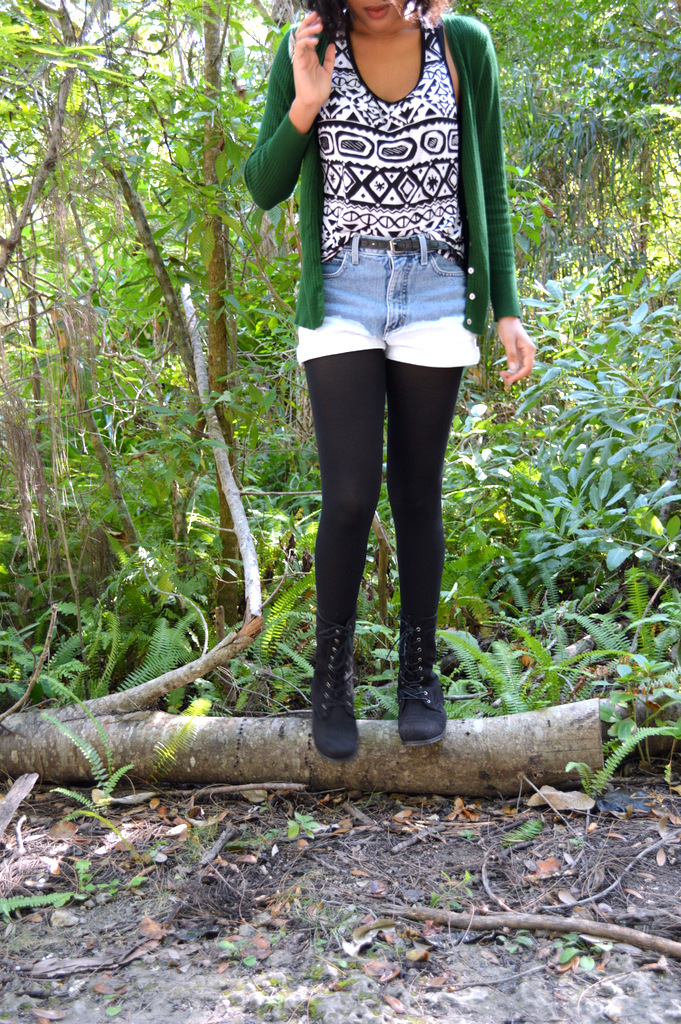 Fashion Blogger Anais Alexandre of Down to Stars with a vintage green cardigan, an aztec print top, ombre denim shorts and black combat boots
