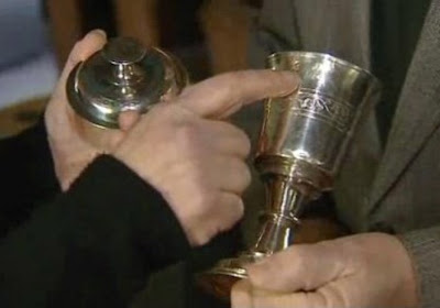 Sara Richards and Canon Loveluck reuniting the lid with the chalice