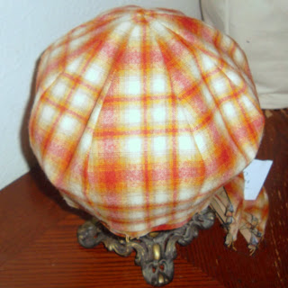 Eight-paneled crown for 'newsboy' style hat in red and gold plaid