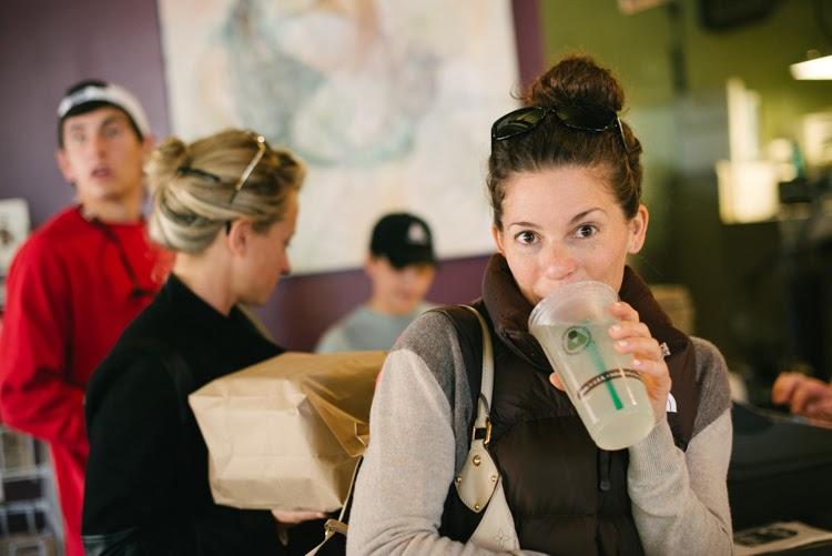 lady at city bagel in starkville mississippi drinking lemonade