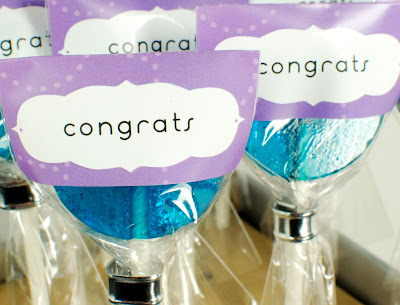 purple congratulations labeled lollipops