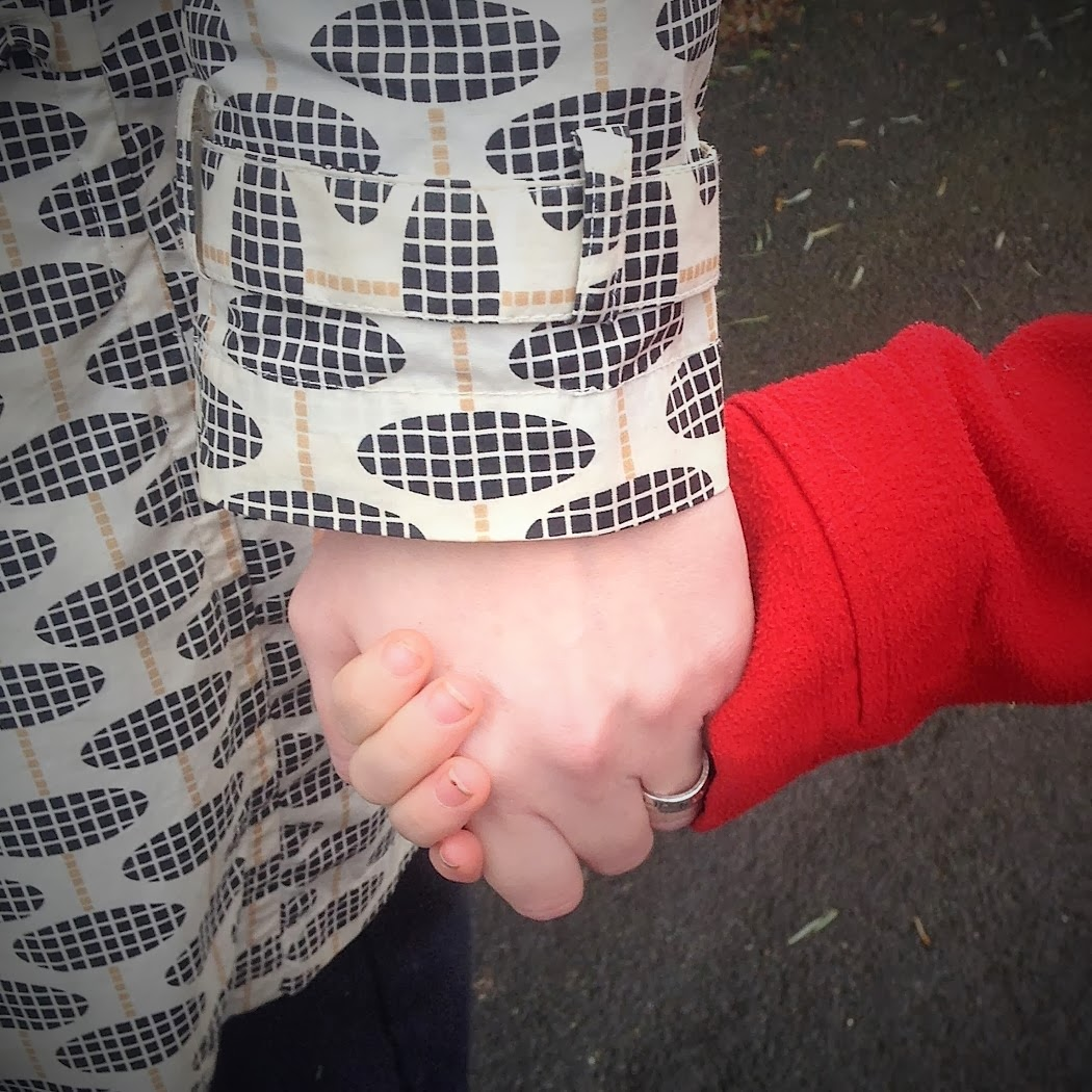 holding hands mum and daughter