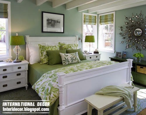 small bedroom in green paint color dark tones, classic bed white