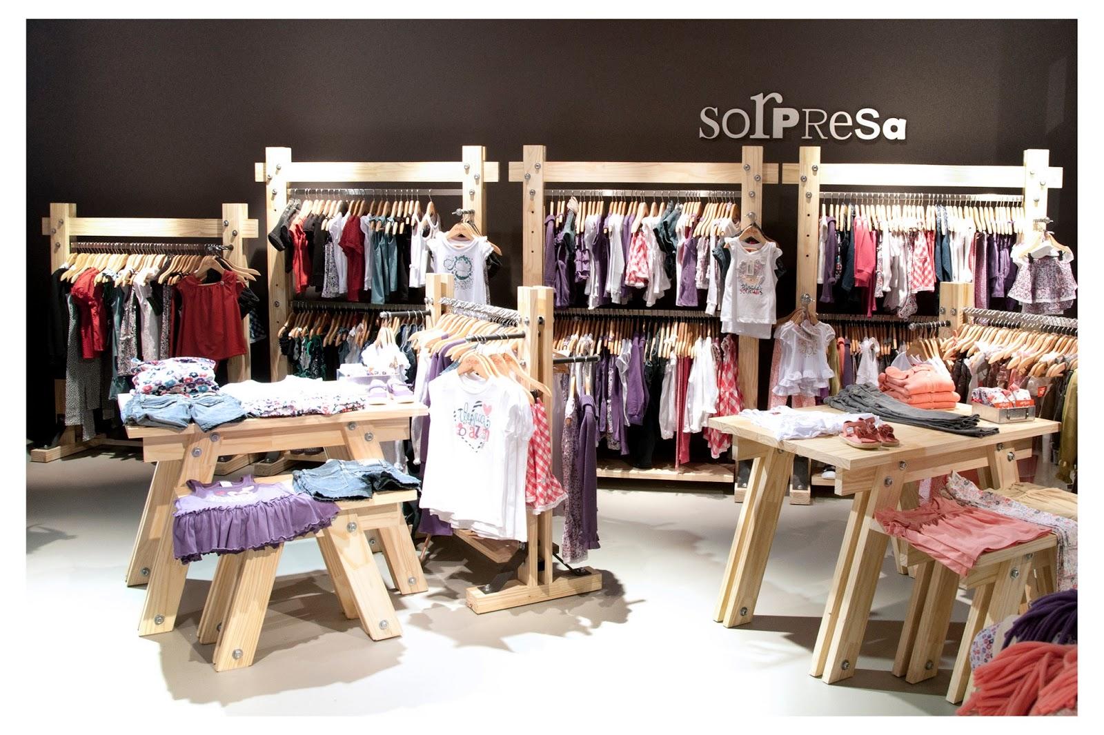 Grisino nuevas tiendas con nueva imagen decora for Decoracion de negocios de ropa
