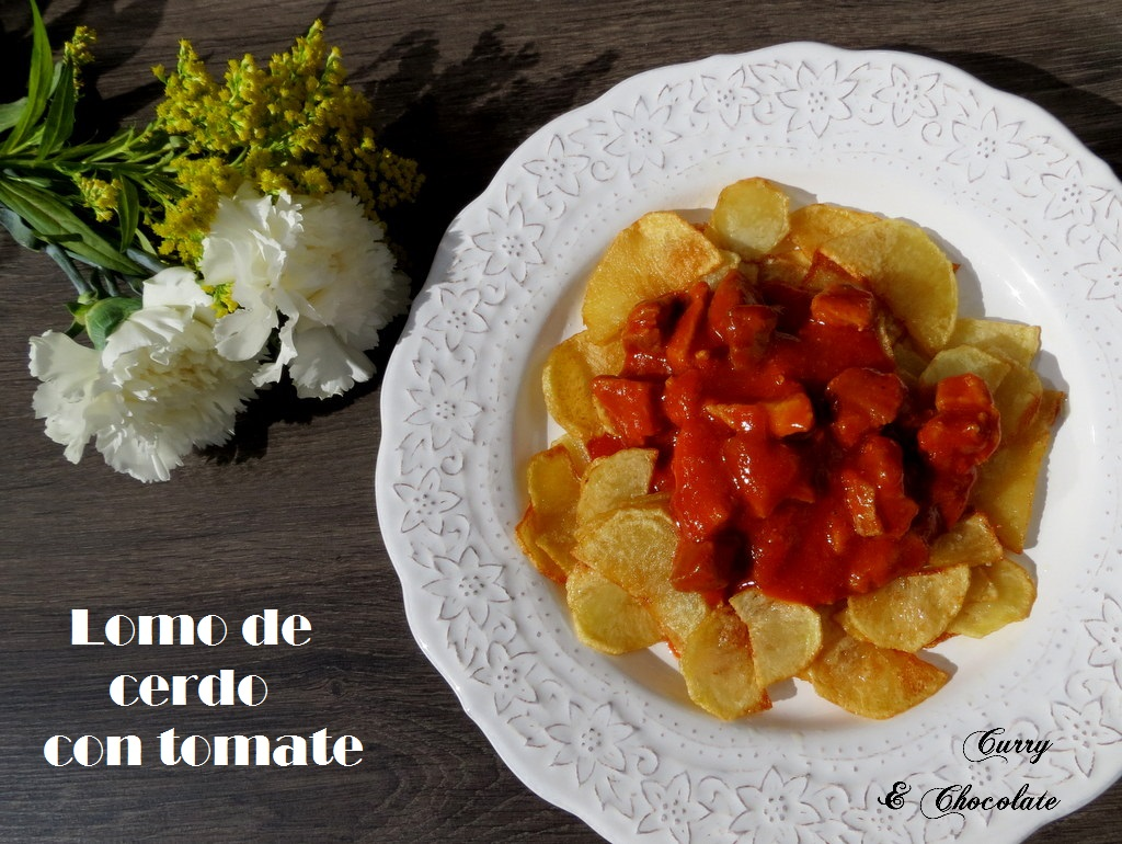 Lomo con tomate y patatas fritas