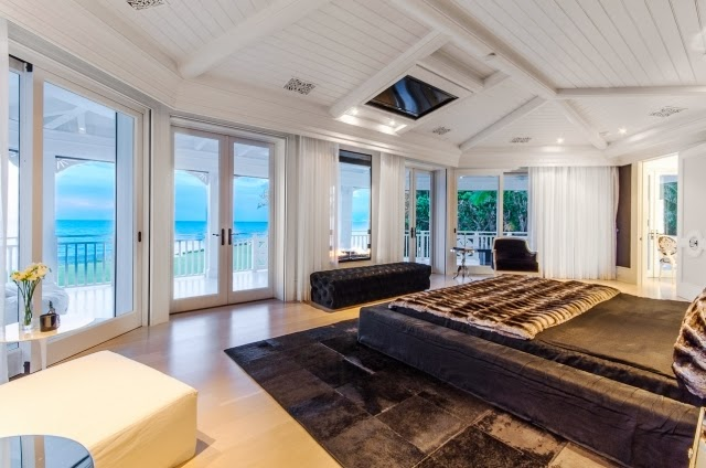 Bedroom in Celine Dion's home with a view of the ocean, a grey bed and matching rug