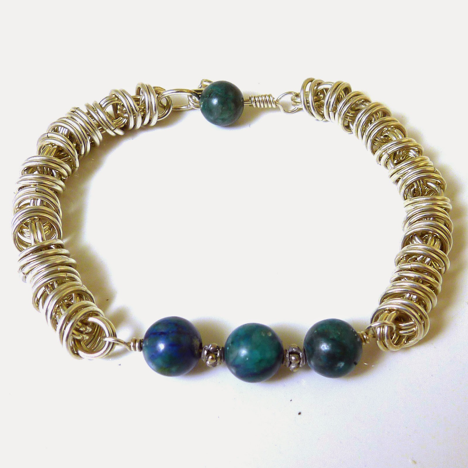 http://www.shazzabethcreations.co.nz/#!product/prd1/2461425451/chrysocolla-orbital-sterling-chainmaille-bracelet