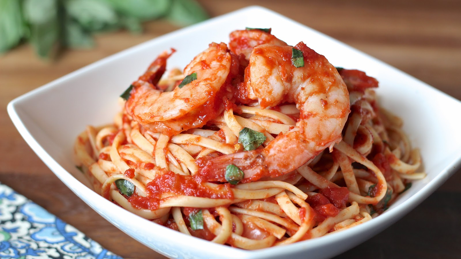 Tender shrimp in a spicy white wine and tomato-based sauce. Served ...