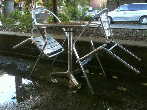 coffee shop, patio furniture, chairs, table, parked cars