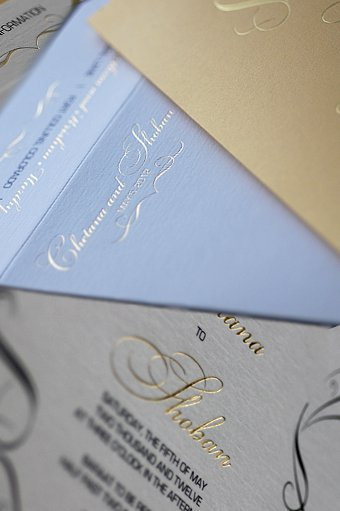 The Indian wedding invitation included a fold paper folio to carry the event
