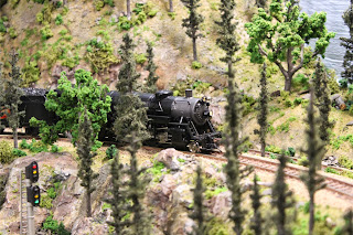 Locomotive 3725 along the mountain bluffs