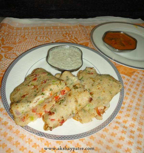 Oats rava uttapa or uttapam in a serving plate