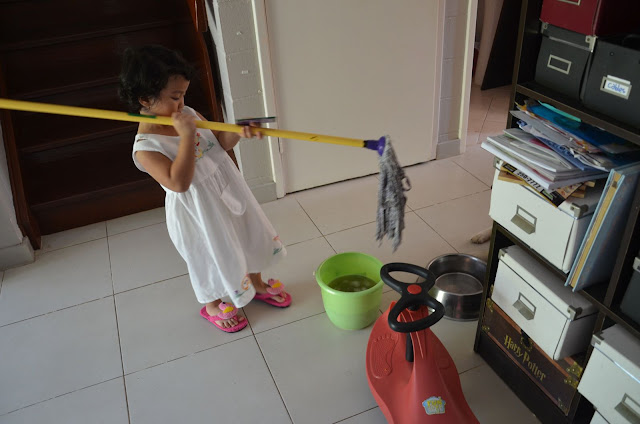 Kecil playing with the mop