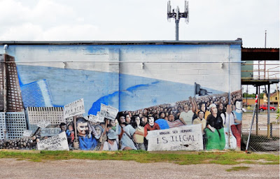 """""""No Human Being Is Illegal"""" (mural with a message)"""