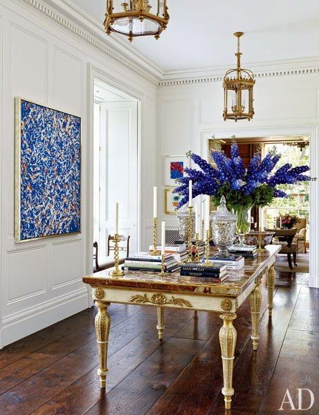 beautiful white and blue formal dining room gold lighting and accents