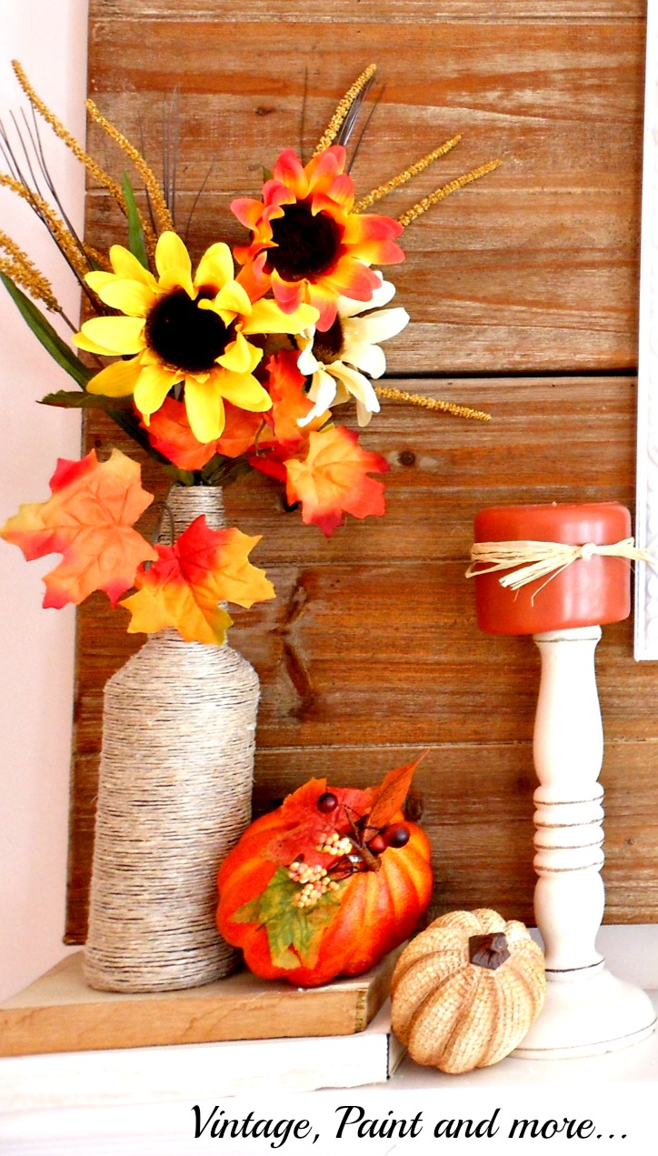 Vintage, Paint and more... twine wrapped bottle with faux flowers and dollar store pumpkins for a traditional fall mantel