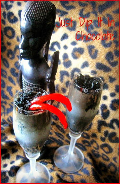 Spiked Black Mamba Halloween Cocktail Recipe, if you are terrified of snakes, this one you will love! A Sweet combination of Malibu, Coffee and Cacao...Poison has never been so sweet! #Halloween #halloweenpartydrinks #halloweenfood #cocktails #snakes