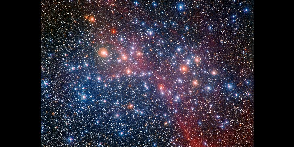 The MPG/ESO 2.2-metre telescope at ESO's La Silla Observatory in Chile captured this richly colourful view of the bright star cluster NGC 3532. Some of the stars still shine with a hot bluish colour, but many of the more massive ones have become red giants and glow with a rich orange hue. Credit: ESO/G. Beccari