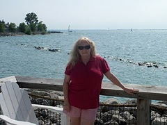 photo of author BJ Robinson standing in front of body of water