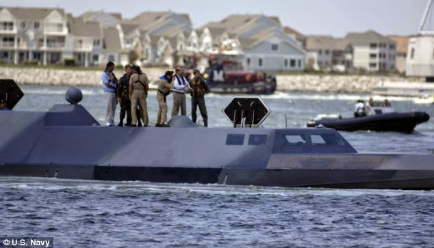 http://www.dailymail.co.uk/news/article-2644311/The-secret-stealth-boats-designed-Navy-SEALs-regularly-spotted-Columbia-river.html