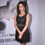 Madhurima latest photo shoot in mini black skirt showing her legs