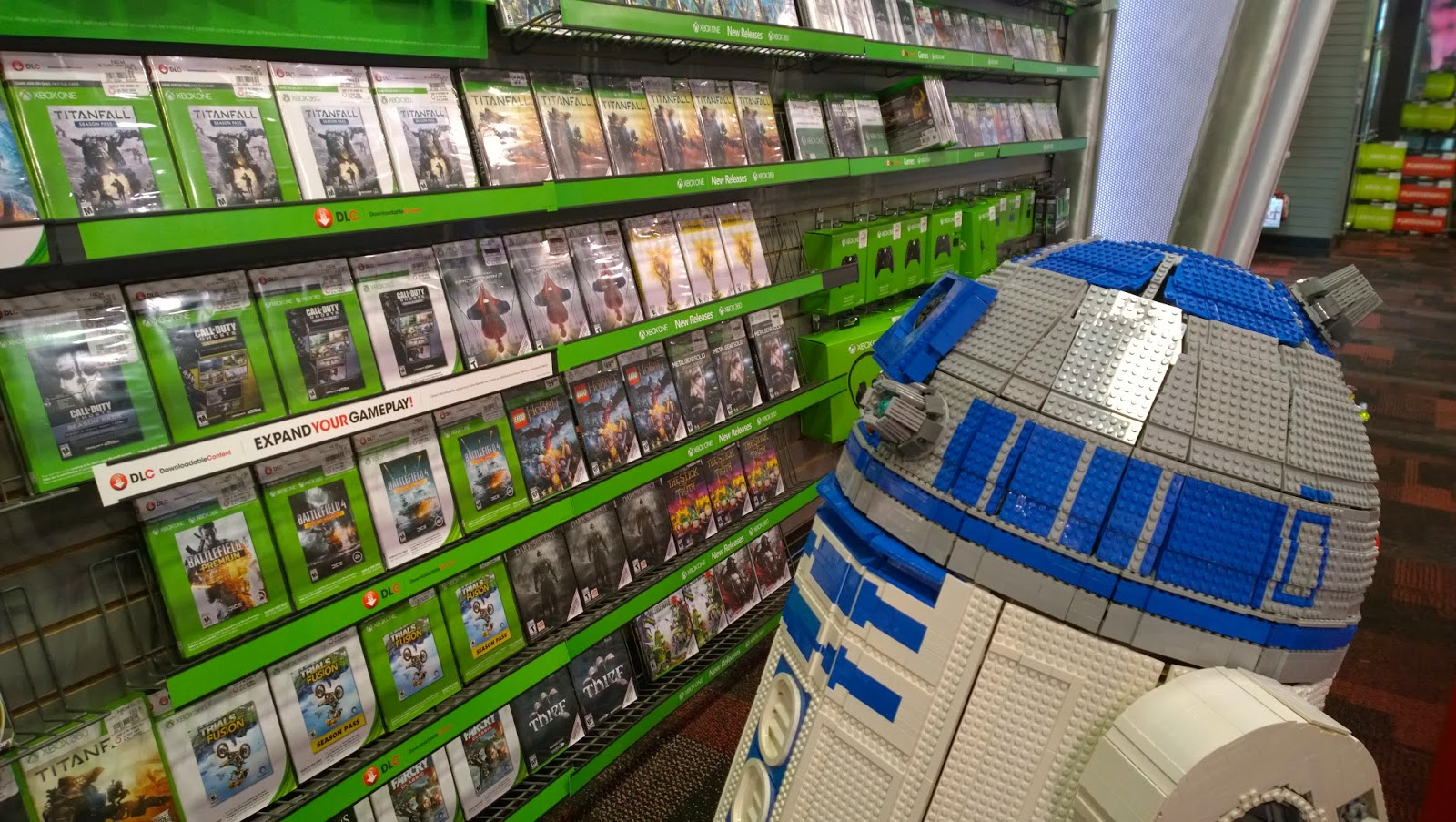 L3-G0 the Lego R2D2 perusing a shelf of XBox One games
