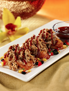 ... roasted pork over sweet plantains, served with slightly smoky guava