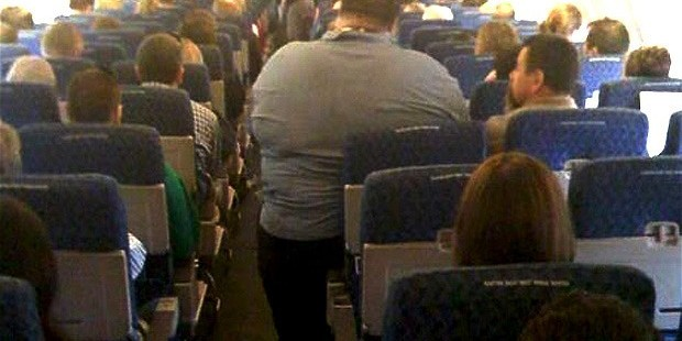 Air passenger suing for a back injury 'caused by sitting next to obese man'