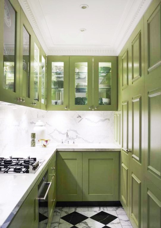 small gallery kitchen galley kitchen with avocado green cabinets, a