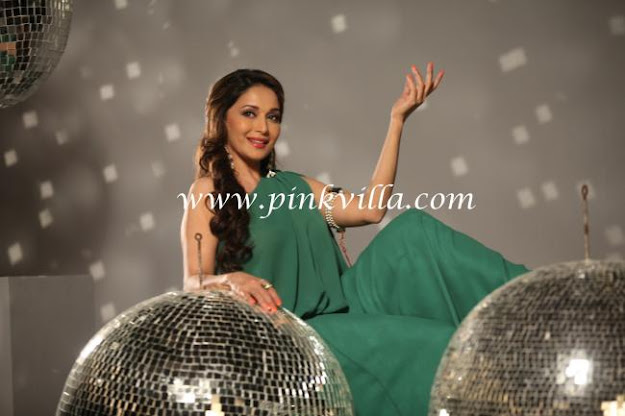 Madhuri posing with silver balls in a green dress - (2) -  Madhuri Dixit Nene - new pics !!!